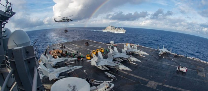 This US Navy photo obtained February 7, 2017 shows the aircraft carrier USS Carl Vinson (CVN 70) participating in a vertical replenishment-at-sea with the Black Knights of Helicopter Sea Combat Squadron (HSC) 4 and the Military Sealift Command dry cargo and ammunition ship USNS Charles Drew (T-AKE 10)in the Pacific Ocean on February 3, 2017 .  The Carl Vinson Carrier Strike Group is on a scheduled western Pacific deployment as part of the US Pacific Fleet-led initiative to extend the command and control functions of US. 3rd Fleet. US Navy aircraft carrier strike groups have patrolled the Indo-Asia-Pacific regularly and routinely for more than 70 years.  / AFP PHOTO / Navy Media Content Operations (N / MC2 Sean M. CASTELLANO / RESTRICTED TO EDITORIAL USE - MANDATORY CREDIT AFP PHOTO /US NAVY/MC2 SEAN  M. CASTELLANO  - NO MARKETING - NO ADVERTISING CAMPAIGNS - DISTRIBUTED AS A SERVICE TO CLIENTS  MC2 SEAN M. CASTELLANO/AFP/Getty Images