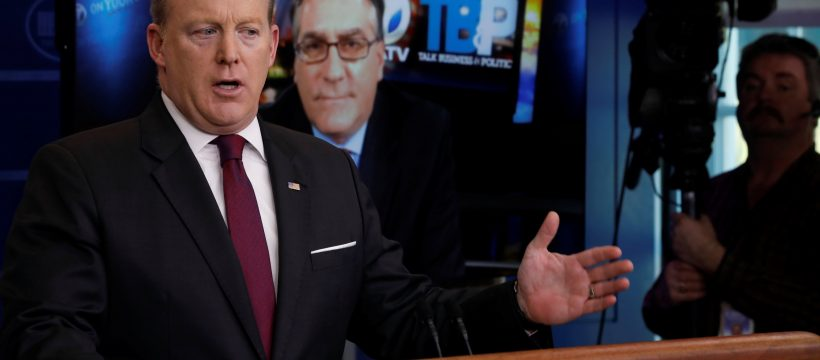White House Communications Director Sean Spicer (L) takes a remote question from Roby Brock (2nd L) of KATV television in Little Rock, Arkansas, during the daily press briefing at the White House in Washington, U.S. February 23, 2017. REUTERS/Jonathan Ernst